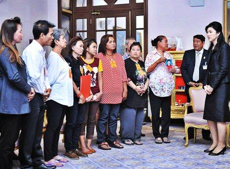Families of the fallen meet Yingluck Shinawatra